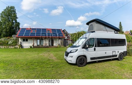 Kuressaare, Estonia - 13 August, 2021: Gray Camper Van Parked At A Campground With A Sanitary Facili