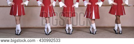 Close-up Of A Group Of Woman Dancing Traditional Irish Dances. Legs Of A Dance Ensemble