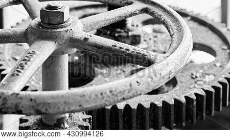 Old Grunge Steampunk Valve Wheel With Gear Gearbox Selective Focus With Handle Grip Over Out Of Focu