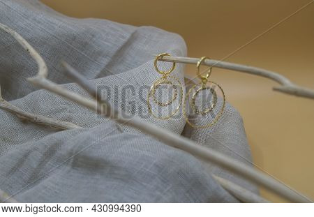 Golden Jewellery Setup. Golden Jewelry Fashion Photography. Golden Earrings White Crystals And Diamo