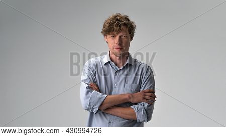 Handsome Hipster Guy Standing With Arms Folded Isolated On Light White Pastel Background. Closeup Ph