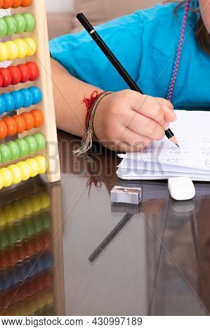 Little Girl Doing Math Homework With An Abacus. Back To School Concept, Homework, Learning Math