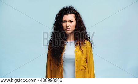Dissatisfied Woman In Orange Shirt Looking Away Isolated On Blue