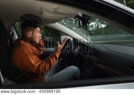 Stressed Man In Driver's Seat Of Modern Car