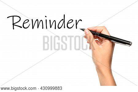 Woman Writing Word Reminder On White Background, Closeup