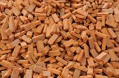 Heap of red brick materials for construction poster