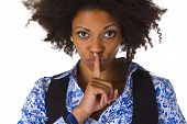 Young afro american saying shhh- be quiet - isolated on white background poster