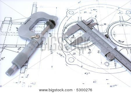Micrometer and caliper on blueprint horizontal
