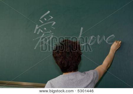 Teacher In Front Of Blackboarder