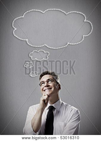 Man thinking solution over gray dark background