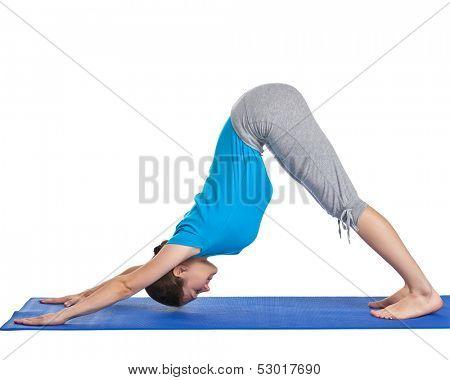 Yoga - young beautiful woman yoga instructor doing downward facing dog pose (adho mukha svanasana) exercise isolated on white background poster