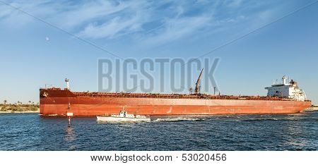 Big Red Oil Tanker Passes Through The Suez Canal With Small Pilot Boat