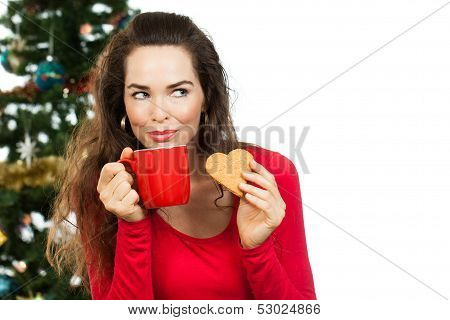Beautiful Woman Enjoying Hot Drink And Gingerbread