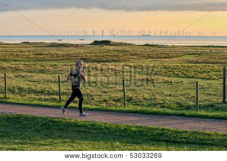 Young jogger in old environment
