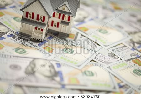 Small Model House on Newly Designed U.S. One Hundred Dollar Bills.