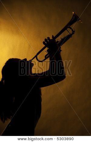 Teenage Girl Trumpet Player In Silhouette