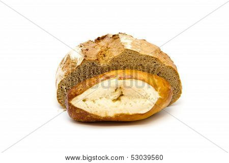Fresh Baked Brown Bread with lye bread Roll on white background