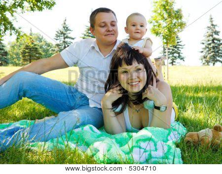 Family Having Rest In  Park