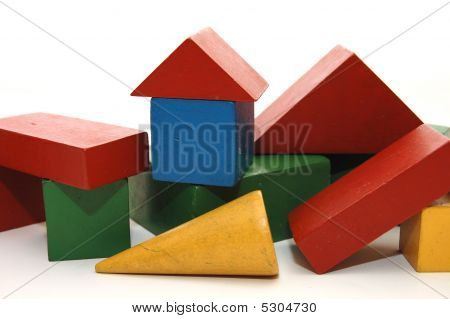 building from wooden colourful children blocks on white poster