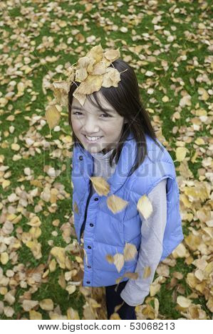 Girl Has Leaves On Her Head.