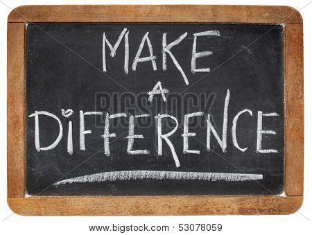 make a difference -motivational phrase - white chalk handwriting on a vintage slate blackboard