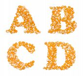 Letter set made of corn seeds - capital letters A B C D poster