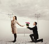 angry young woman rejecting man with flowers poster