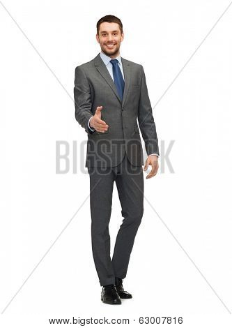 business and office concept - handsome buisnessman with open hand ready for handshake