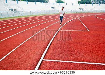 Cropped Image Of  Runner On Competitive Running