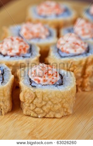 Sushi roll with fresh cream cheese and tobico