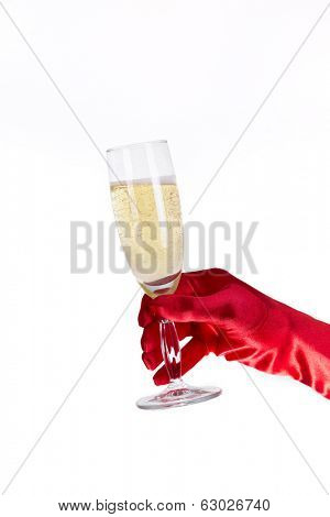 Female hand in red opera glove holding champagne glass, isolated on white background