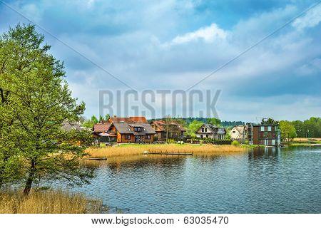 Houses on embankment of Galve lake. Trakai Lithuania poster