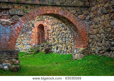 Stone Arch And Wall In Internal Courtyard