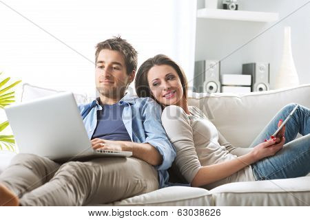 Couple Surfing The Net At Home
