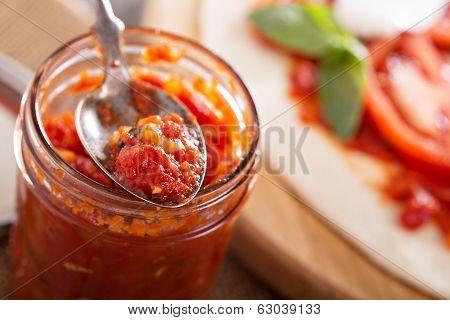 Pizza sauce in a jar