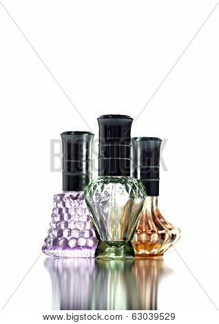 Many Bottle With Perfume Different Color Isolated.