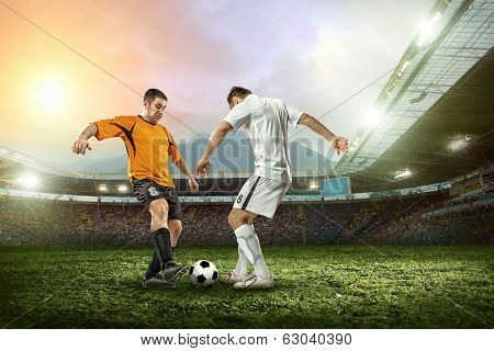 Soccer player with ball in action outdoors. poster