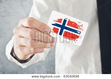 Norwegian Businessman Holding Business Card With Norway Flag