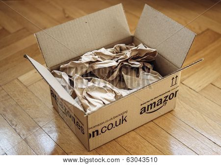 Opened Parcel From Amazon On Home Parquet Floor