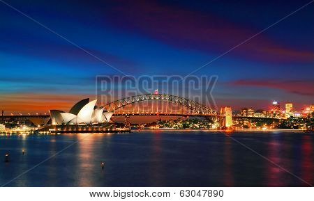 Sydney Opera House And Harbour Bridge At Sundown