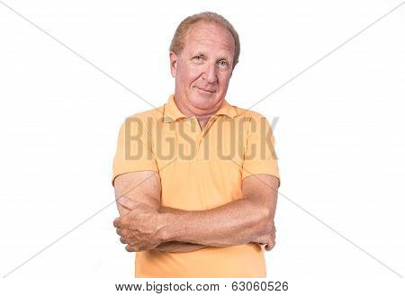 Handsome Old Man In Orange Polo-shirt Hands Crossed