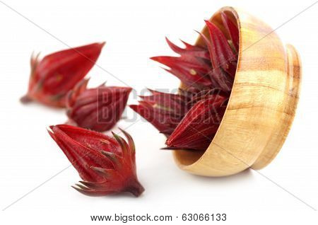 Fresh Roselle and a wooden bowl over white background poster