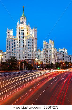 Stalin skyscraper and road traffic on the embankment of the Moscow River