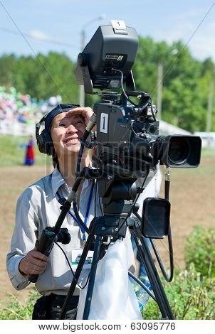 Television Cameraman At Work