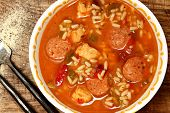 Spicy Cajun Chicken and Sausage Rice Gumbo on Table poster
