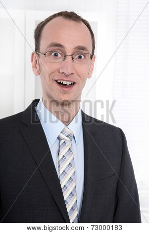 Portrait of smiling businessman with glasses in suit and tie