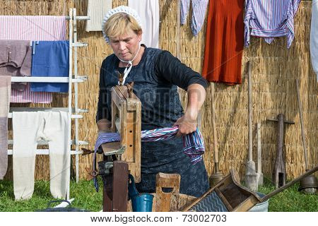 Farmer Woman Shows The Use Of A Traditional Washhub During A Dutch Agricultural Festiva
