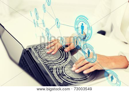 office, business, technology, networking and internet concept - businesswoman using her laptop computer