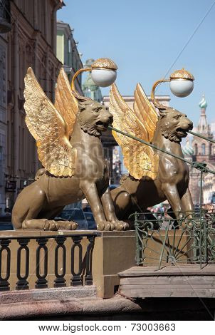 ST. PETERSBURG, RUSSIA - MAY 8, 2012: Winged lions crowning the abutment of the Bank bridge. The bridge across the Griboedov Canal was built in 1826, the sculptures designed by Pavel Sokolov