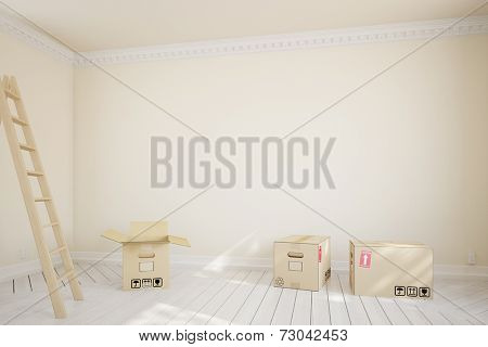 Moving boxes and ladder in empty room during relocation